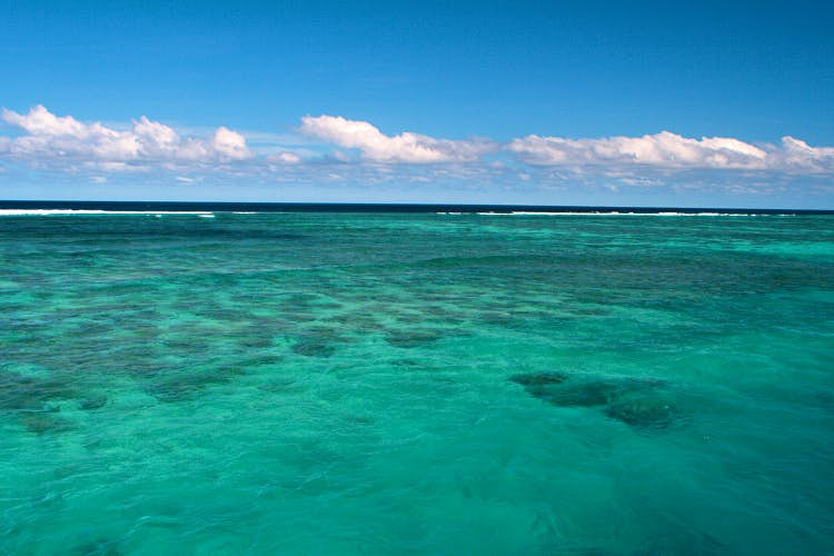 The happy hues of a blue sky and turquoise sea. Image by Christian Haugen / CC BY 2.0