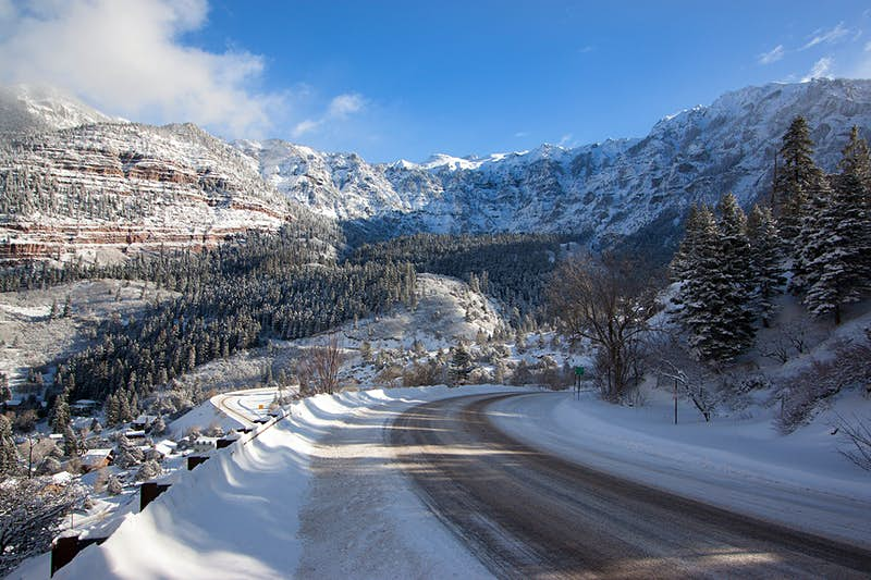 Snow-covered road in the Colorado Rockies. Image by Alan Stark / CC BY-SA 2.0