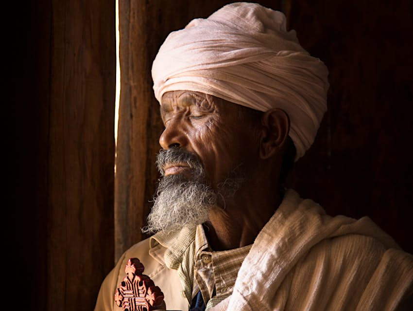 Keshi Teklai Abreha, the priest at the church of Abreha we Atsbeha. Image by Philip Lee Harvey / Lonely Planet