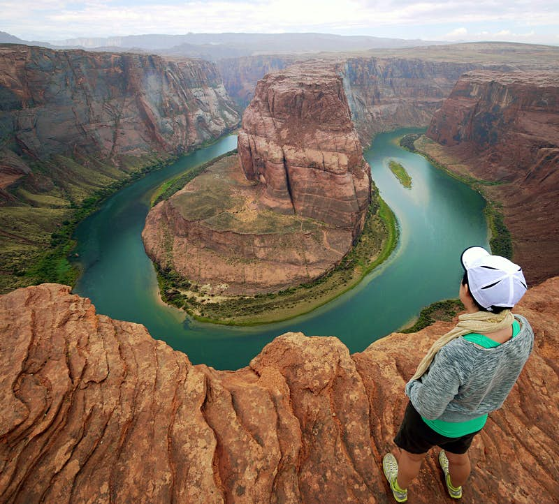 The Colorado River flows far through the famous Horseshoe Bend in Page, Arizona.  Mikel Ortega / Moment / Getty Images