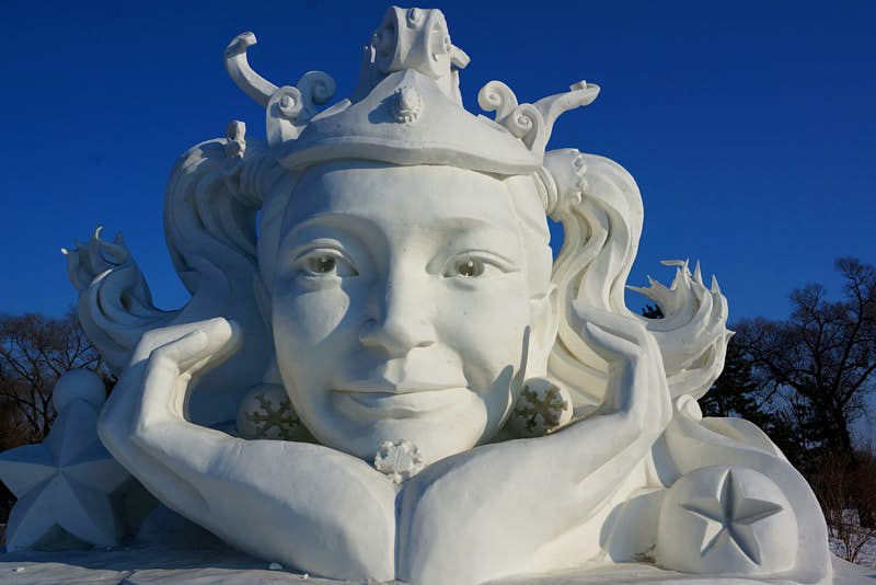 A dreaming snow maiden at Sun Island art exhibition. Image by Anita Isalska / Lonely Planet