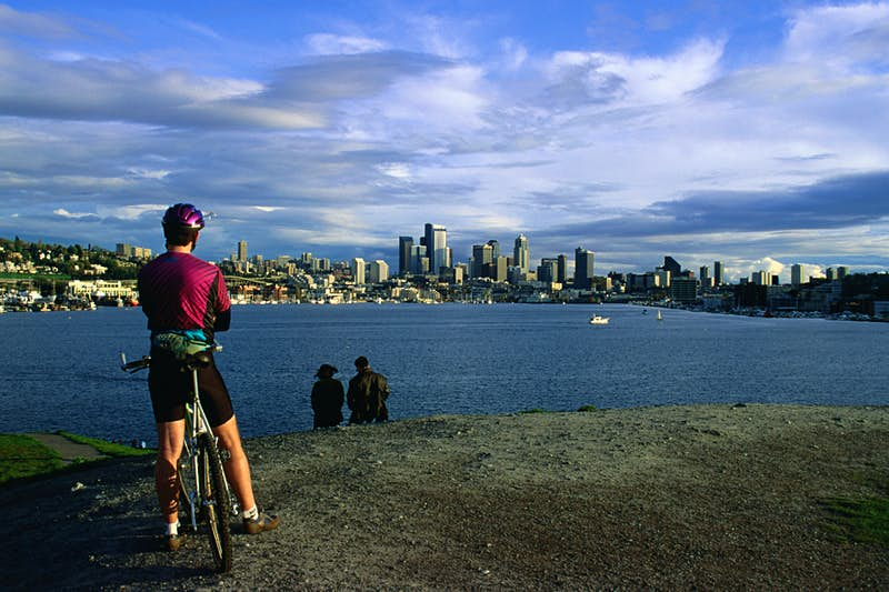 A cyclist takes a break to enjoy the view. Image by Ann Cecil / Getty