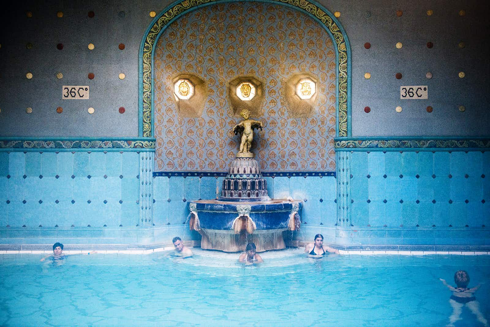 Swim past an art nouveau fountain at Gellért Baths © Will Sanders / Lonely Planet