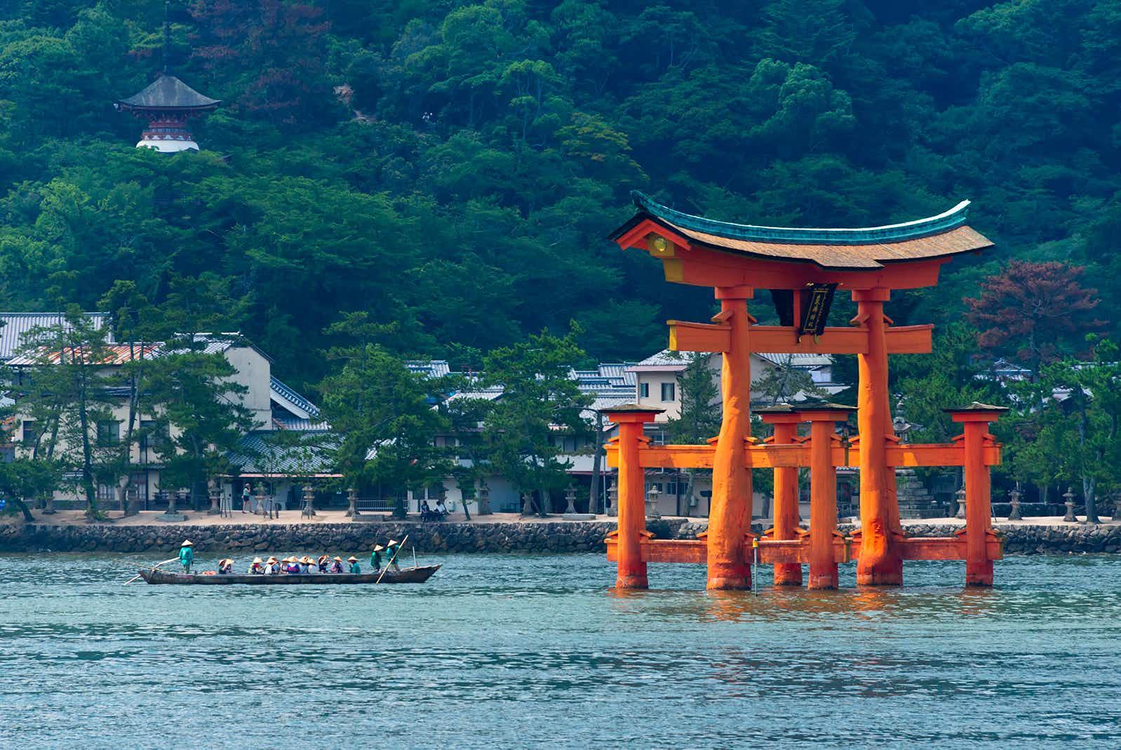 A boat near the Torii Gate of Itsukushima Jinja Shrine during the Kangen-sai Festival in Miyajima, Japan © Keren Su / Getty