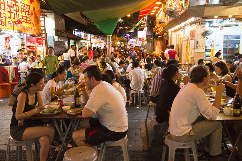 Eating out: night markets and late cafes are Kowloon's specialty. Images by Kylie McLaughlin / Getty