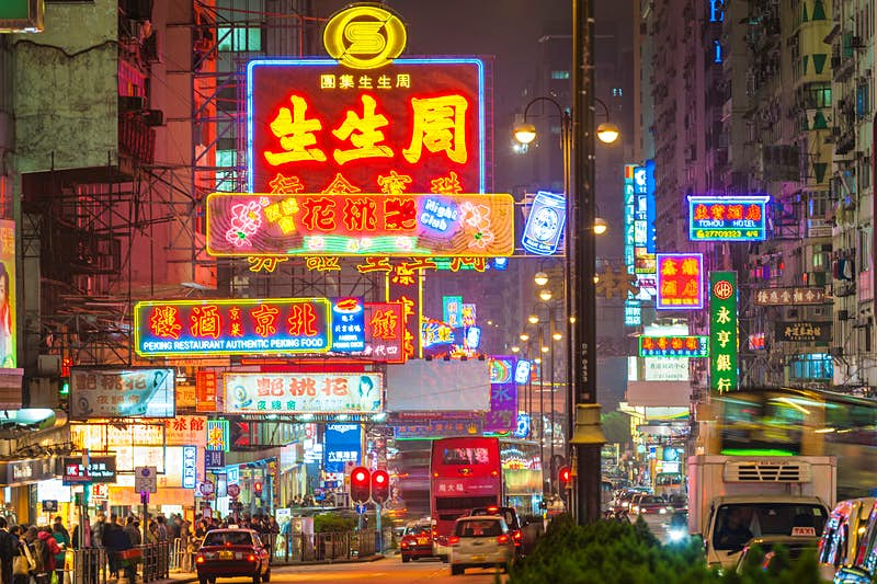 Neon-lit Nathan Road: the bustling heart of Kowloon. Image by fotoVoyager / Getty