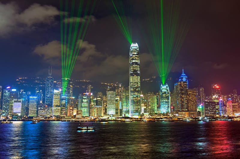 Best views of the Symphony of Lights are from Tsim Sha Tsui promenade. Image by Pavliha / Getty