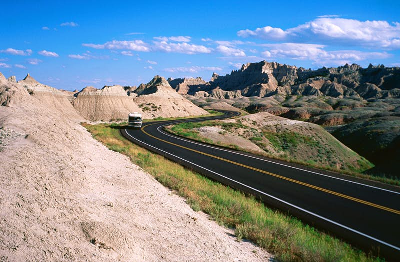 A road through Badlands National Park. Image by Holger Leue / Lonely Planet Images / Getty