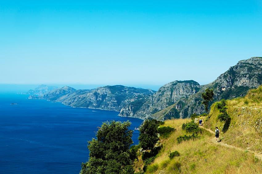 Hikers on Sentiero degli Dei (Path of the Gods), which provides incredible views of the Amalfi Coast and the island of Capri.