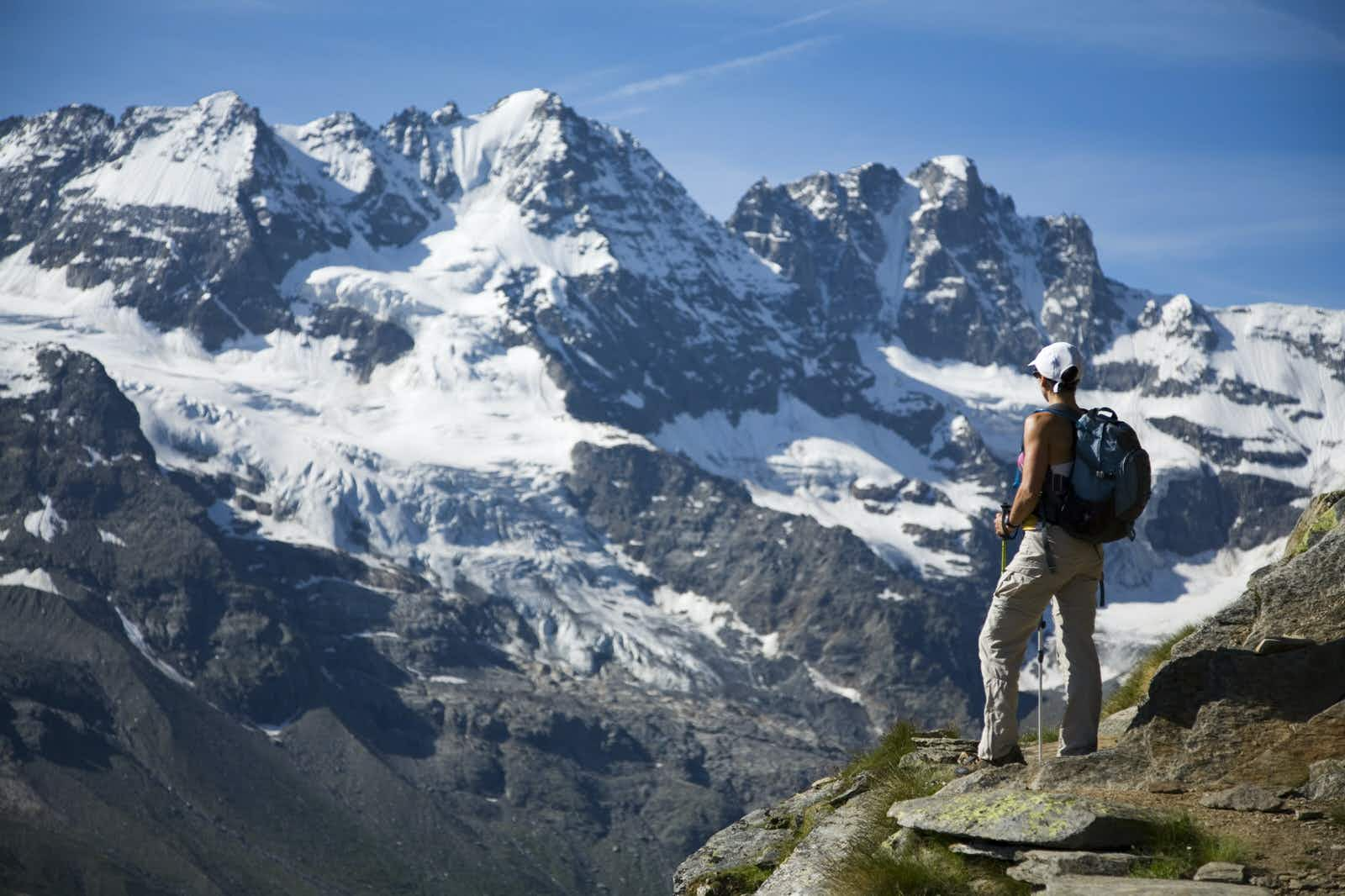Discovering the Dolomite mountains during autumn season during road trip in the Italian Alps. Tre Cime di Lavaredo.