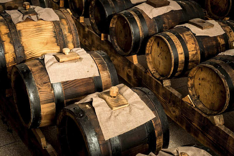 Traditional balsamic vinegar of Modena is left to ferment in wooden barrels for several years