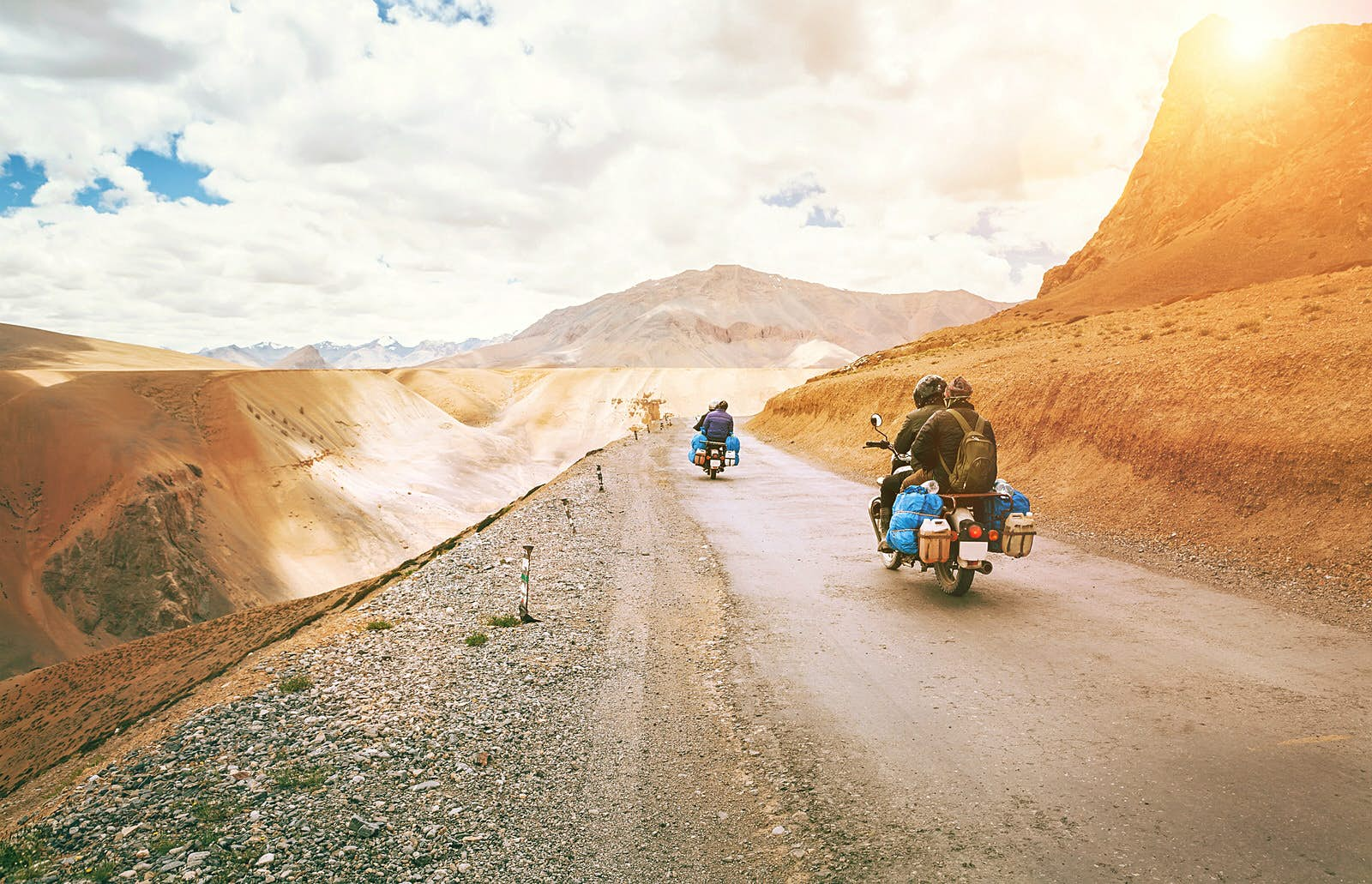 Motorcycle riders on high altitude dirt roads in Northern India