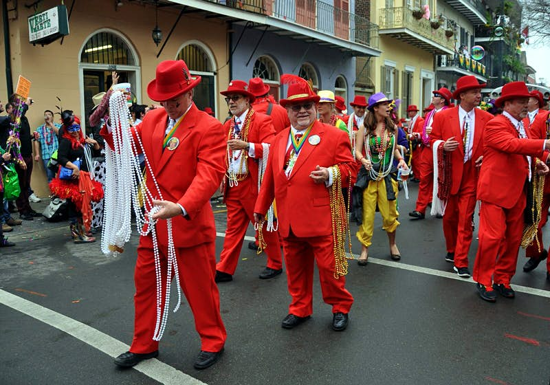 A Mardi Gras parade on Bourbon Street in New Orleans' French Quarter