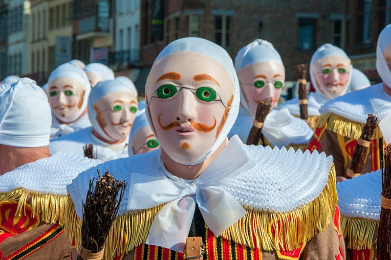 Revellers in the traditional Gilles costume at the Carnaval de Binche