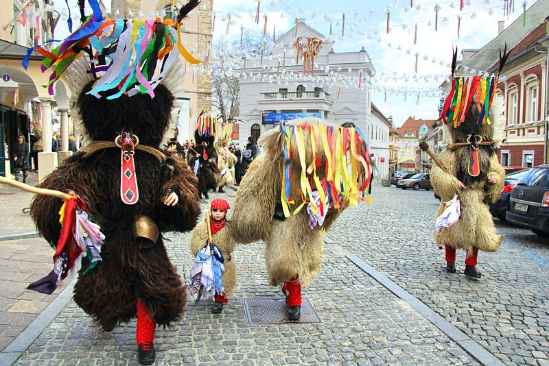 Locals wearing masks and sheepskins to honour Kurent, an ancient god of hedonism, as part of Ptuj's carnival
