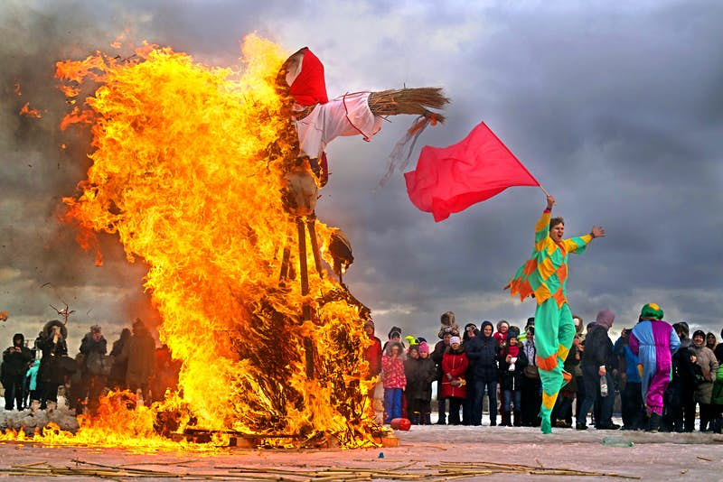 Carnival goers burn dolls to celebrate the arrival of spring as part of Maslenitsa in Russia
