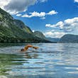 Take a refreshing dip in the clear, cool waters of Lake Bohinj in the Julian Alps © Spanic / Getty Images