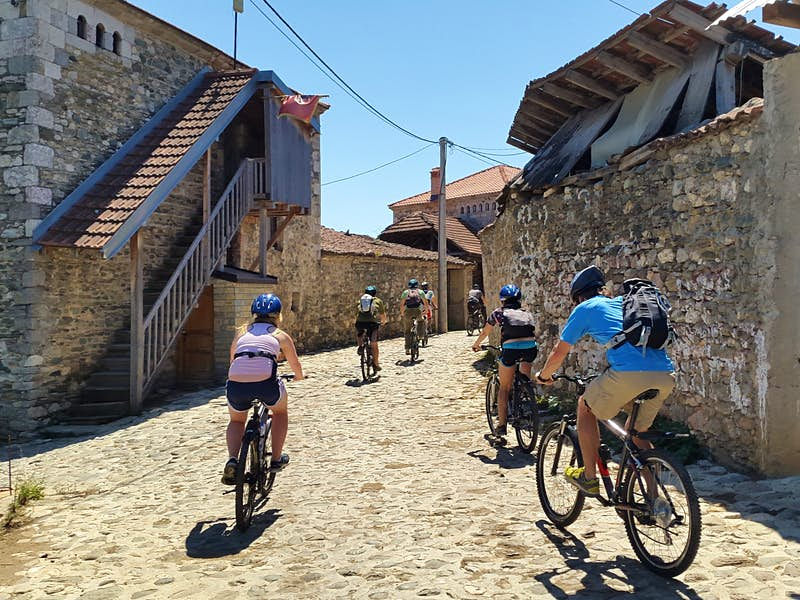 Cycling through a traditional village in Kosovo © courtesy of Catun / Sali Shoshi