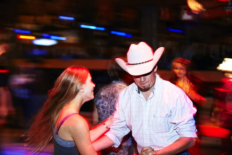 People dancing at Ranchman''s Cookhouse and Dancehall in Calgary © Mark Read / Lonely Planet