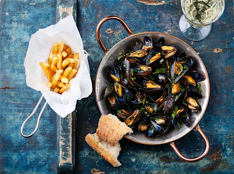 When in Belgium, try the moules-frites © Lisovskaya Natalia/Shutterstock