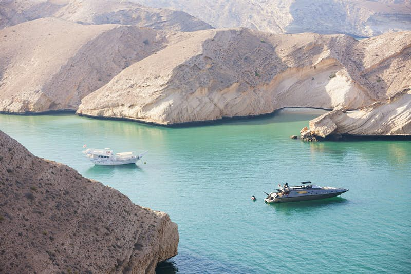 Yachts gently cruise in the Gulf of Oman © Andrew Rowat / Getty Images