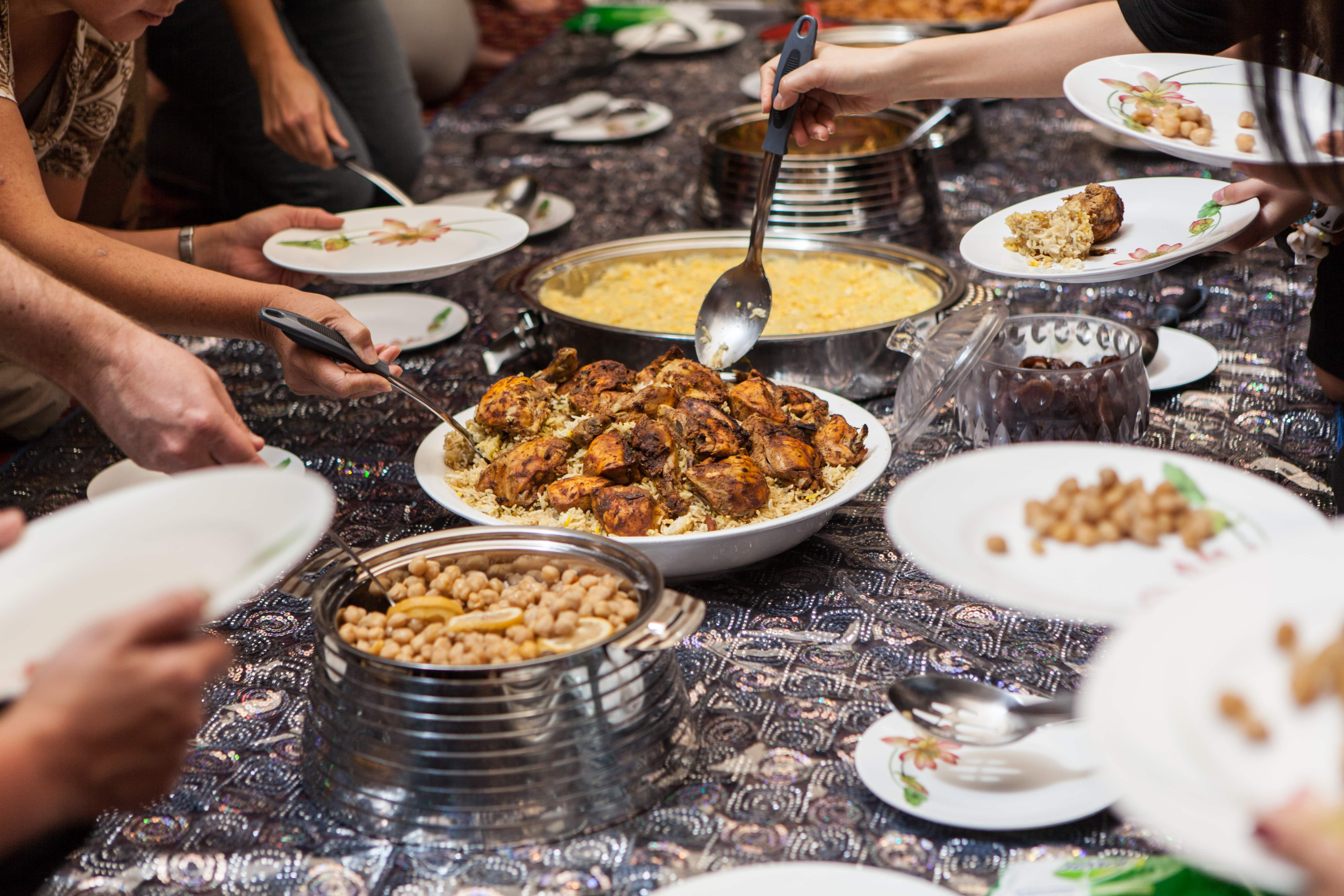 Food is served on the floor in the middle of the majlis at the Sheikh Mohammed Centre for Cultural Understanding in Al Fahidi district, Dubai, UAE