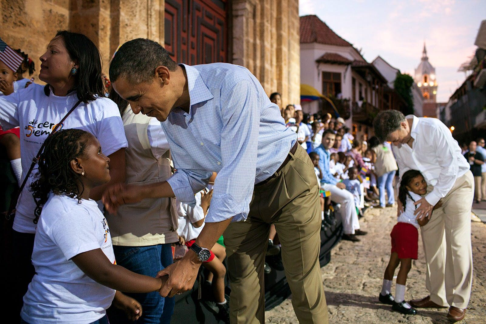 President Obama greeting a young girl at the Plaza de San Pedro, Cartagena, Colombia, during the Summit of the Americas, April 15, 2012©Pete Souza /Official White House Photo