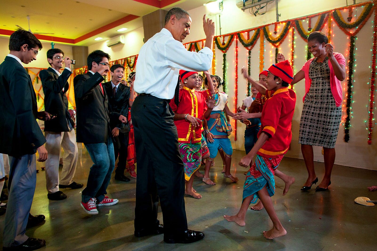 The president dancing with school children and the First Lady in Mumbai, India, Nov 7, 2010©Pete Souza / Official White House Photo