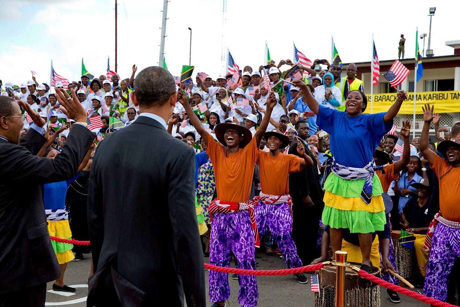 President Obama watching performers on the tarmac at Julius Nyerere International Airport in Dar es Salaam, Tanzania, July 2, 2013©Pete Souza /Official White House Photo