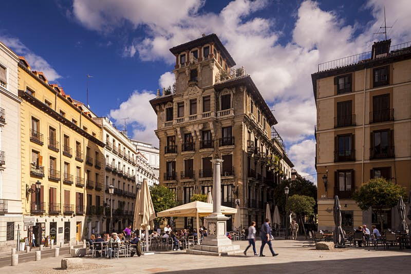 Savour a sun-drenched lunch in Plaza de Ramales © Julian Elliott Photography / Getty Images