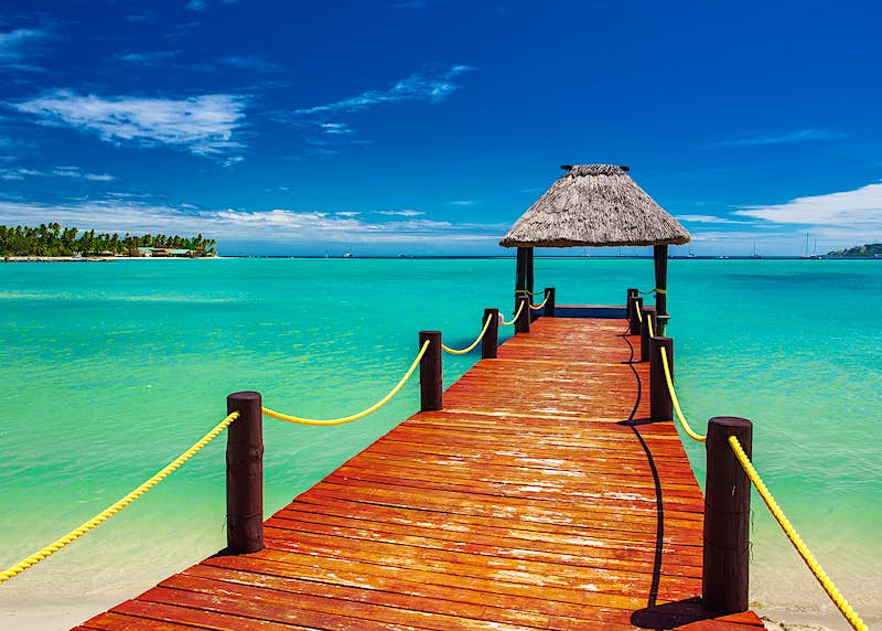 A wooden jetty extending to the tropical seas of Fiji © Martin Valigursky / Shutterstock