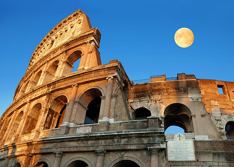A moon rising over the Colosseum, Rome ©Nikonaft / Shutterstock
