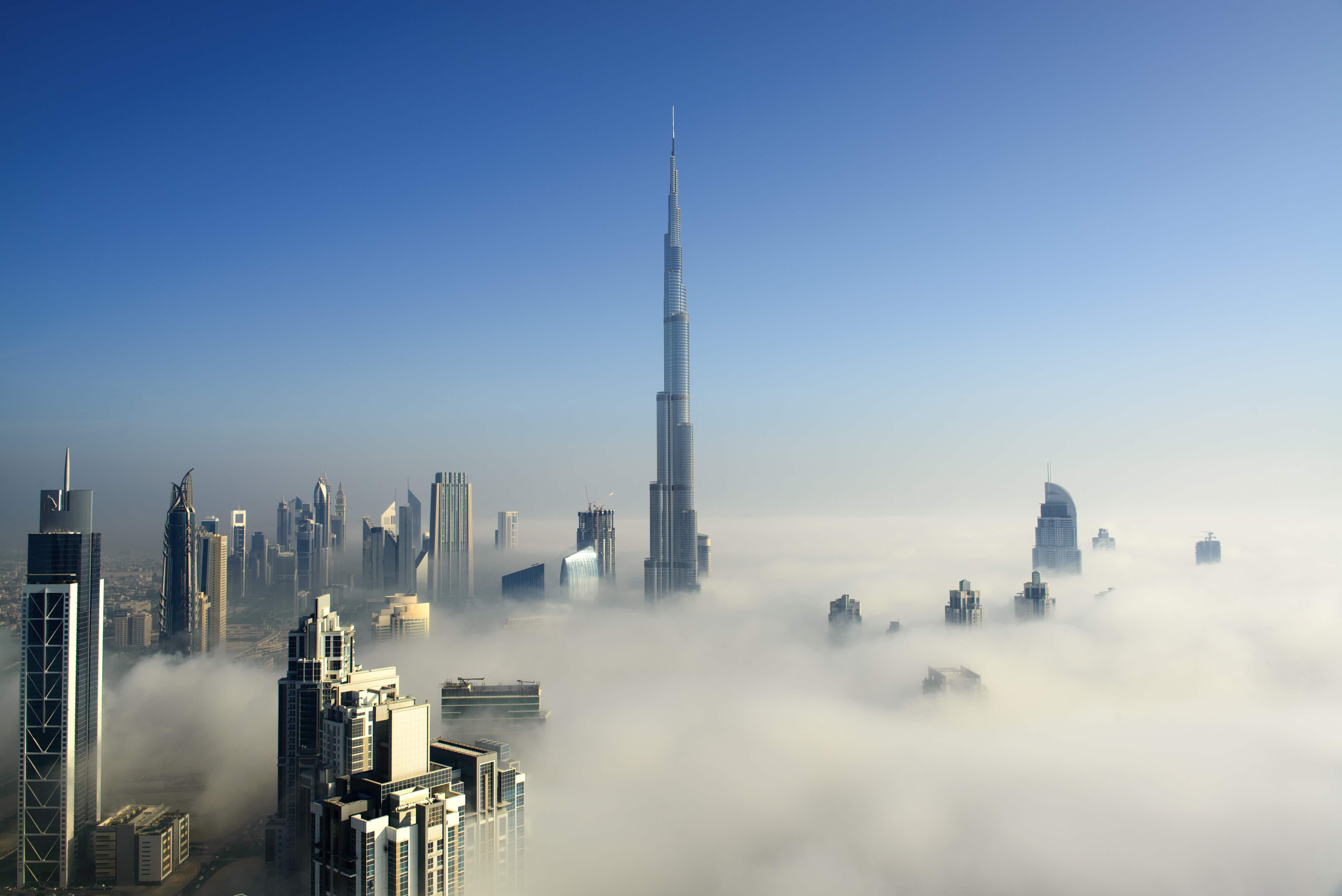 Dubai Downtown Skyline in early morning fog, United Arab Emirates