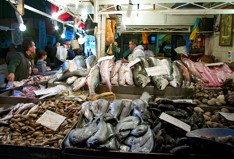 A seafood stall in Santiago's central market piled high with large fish and mollusks. Chile.