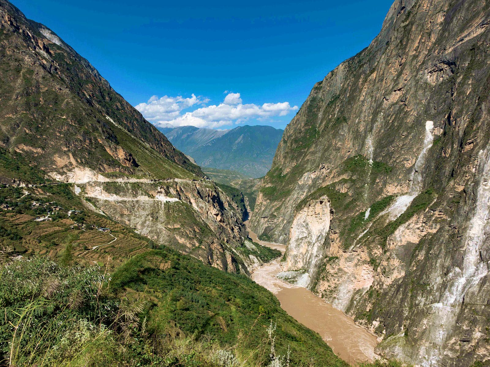 Hiking Tiger Leaping Gorge offers a scenic break from the saddle © Tess Humphrys / Lonely Planet