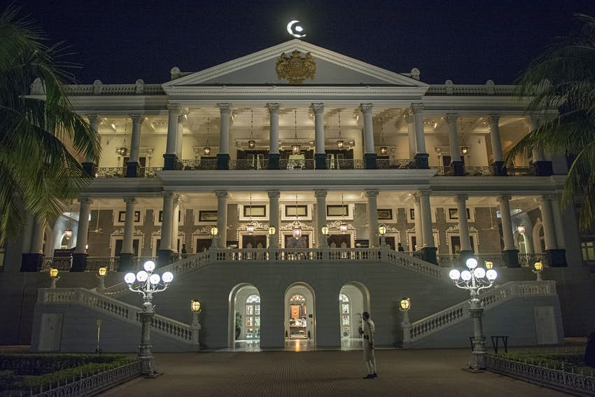 The grand frontage of the Falaknuma Palace at night
