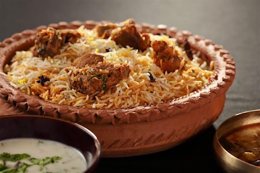 Mughal-inspired mutton biryani in an earthenware bowl