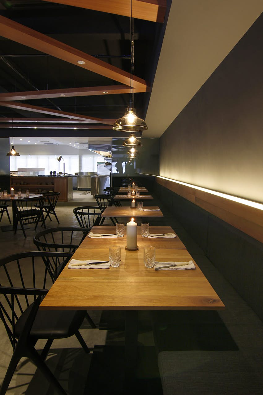 A row of restaurant tables with ambient lighting in Sitka, Damansara Heights, Kuala Lumpur © Image courtesy of Sitka / Studio