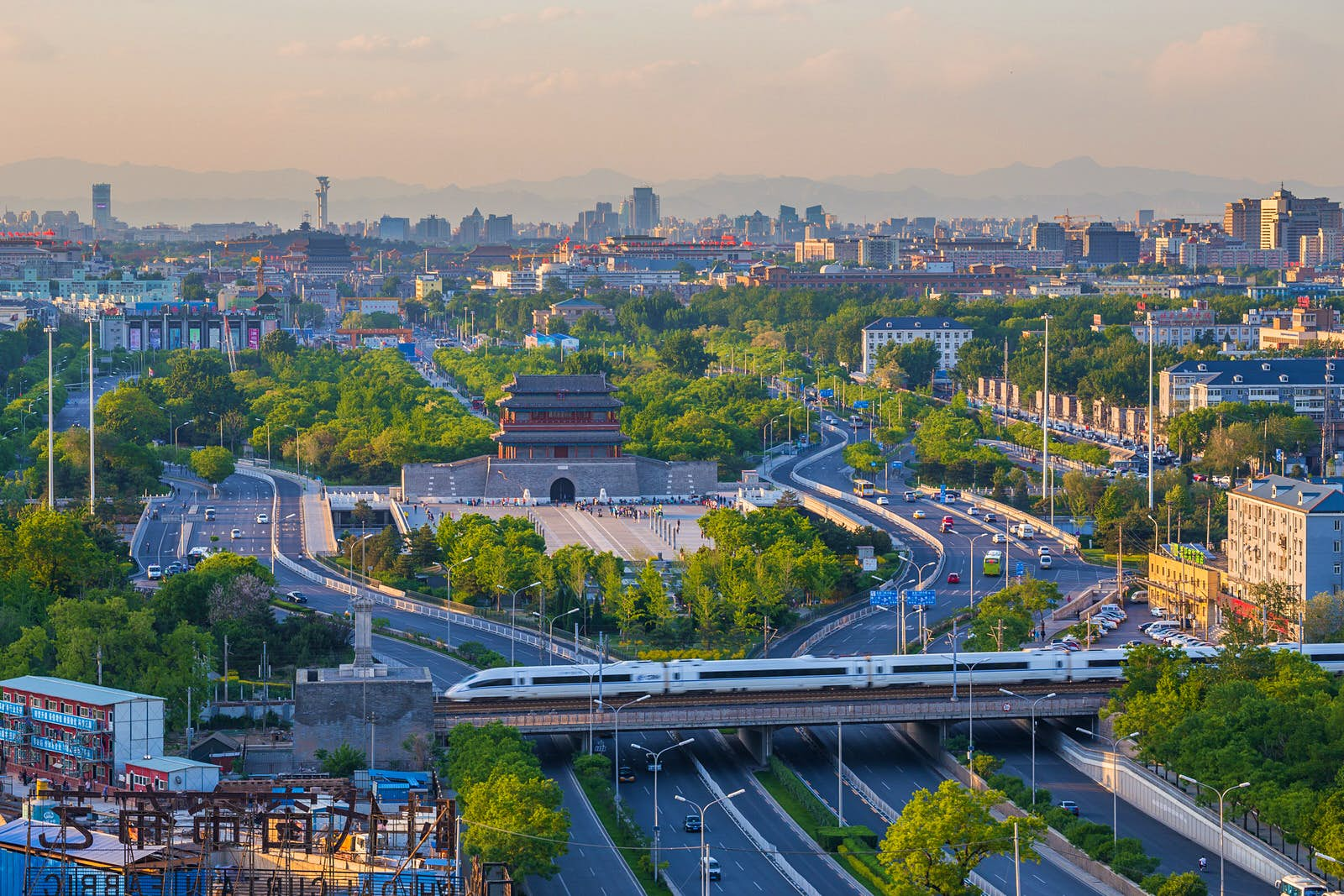 A high-speed train passes Beijing's Yongding Gate before zipping passengers across the country © ViewStock / Getty