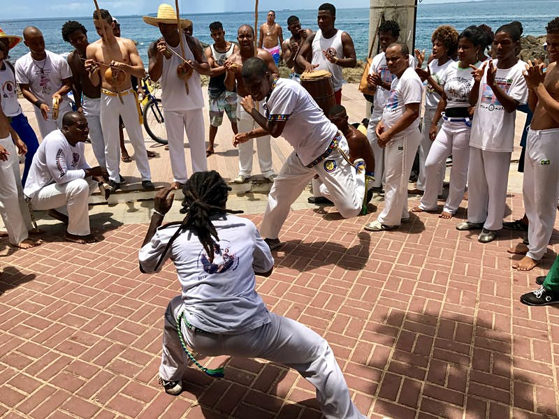 Capoeira performers entertain a crowd on the streets of Salvador, Brazil
