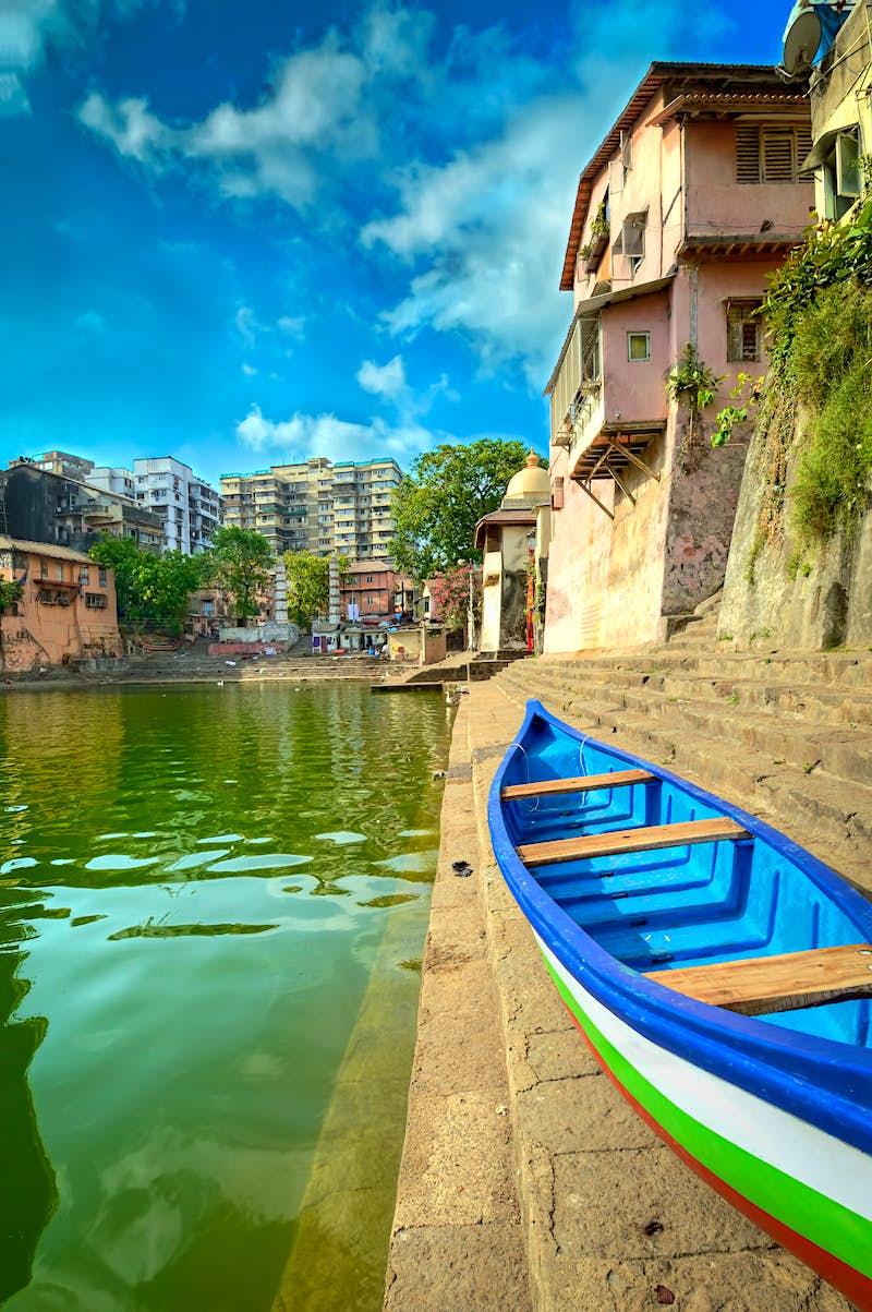 A colourful boat on the banks of the ritzy Malabar Hill district in Mumbai, India