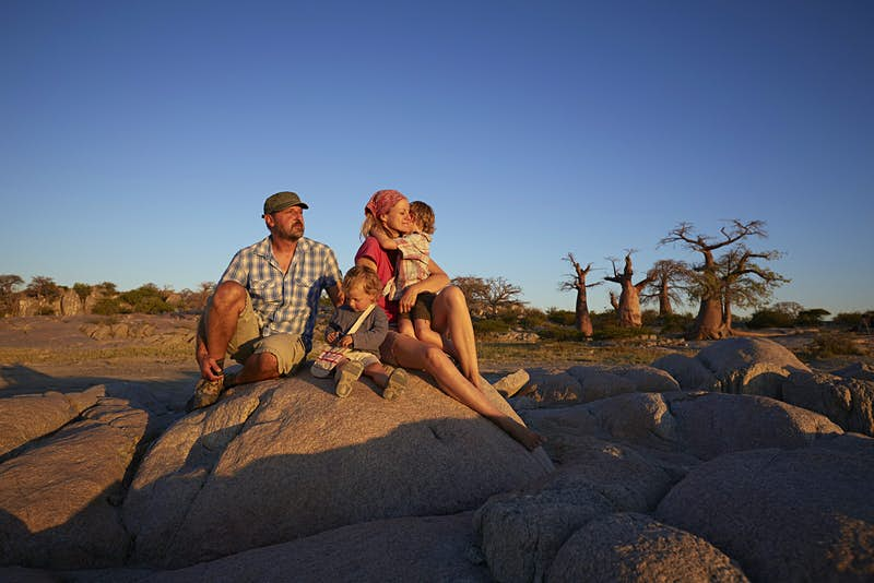 Romantic trip with kids in tow – a family watch the sunset on Kubu Island, Botswana.