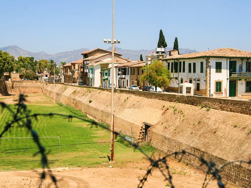 The Turkish side of the Cypriot capital seen through a barbed-wire fence © DPimenov / Shutterstock
