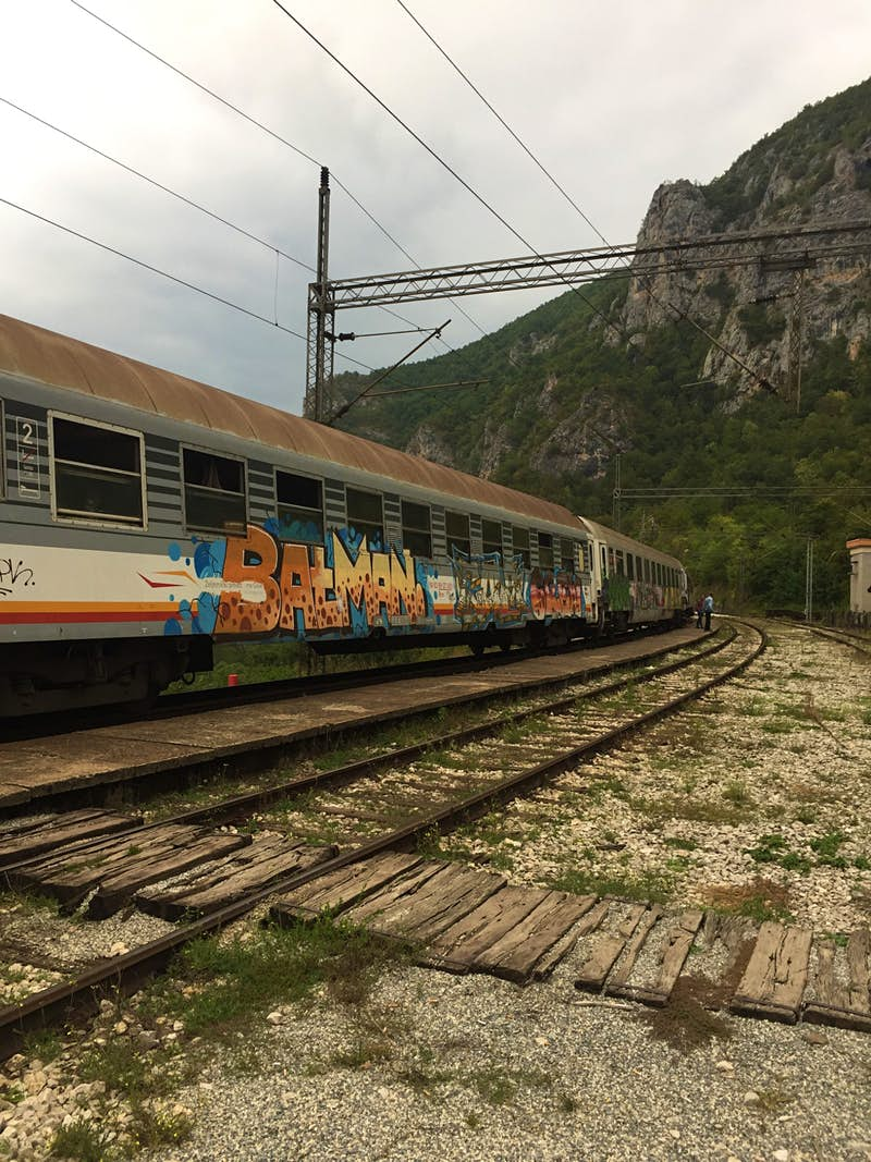 The graffiti-covered carriage at one of the many stops on the Belgrade-Bar railway line