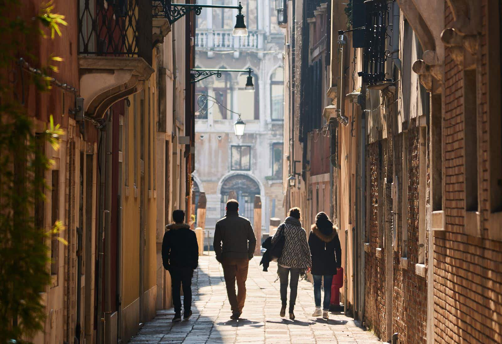 Venice, Italy - Febuary 19, 2016: Walking people in Venice. Venice is a city famous for its settings, archtecture and artwork. A part of Venice is resignated as a World Heritage site.