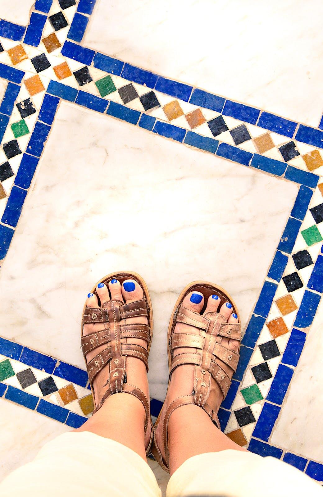 Sandals on North African tiles. Image by Ser Borakovskyy / Shutterstock