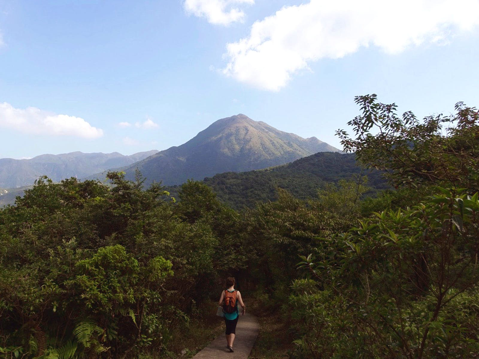 Hiking in the shadow of Lantau Peak is challenging and rewarding © Tess Humphrys / Lonely Planet