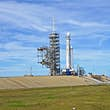 spacex shuttle on the launchpad in Florida, with sunny blue skies