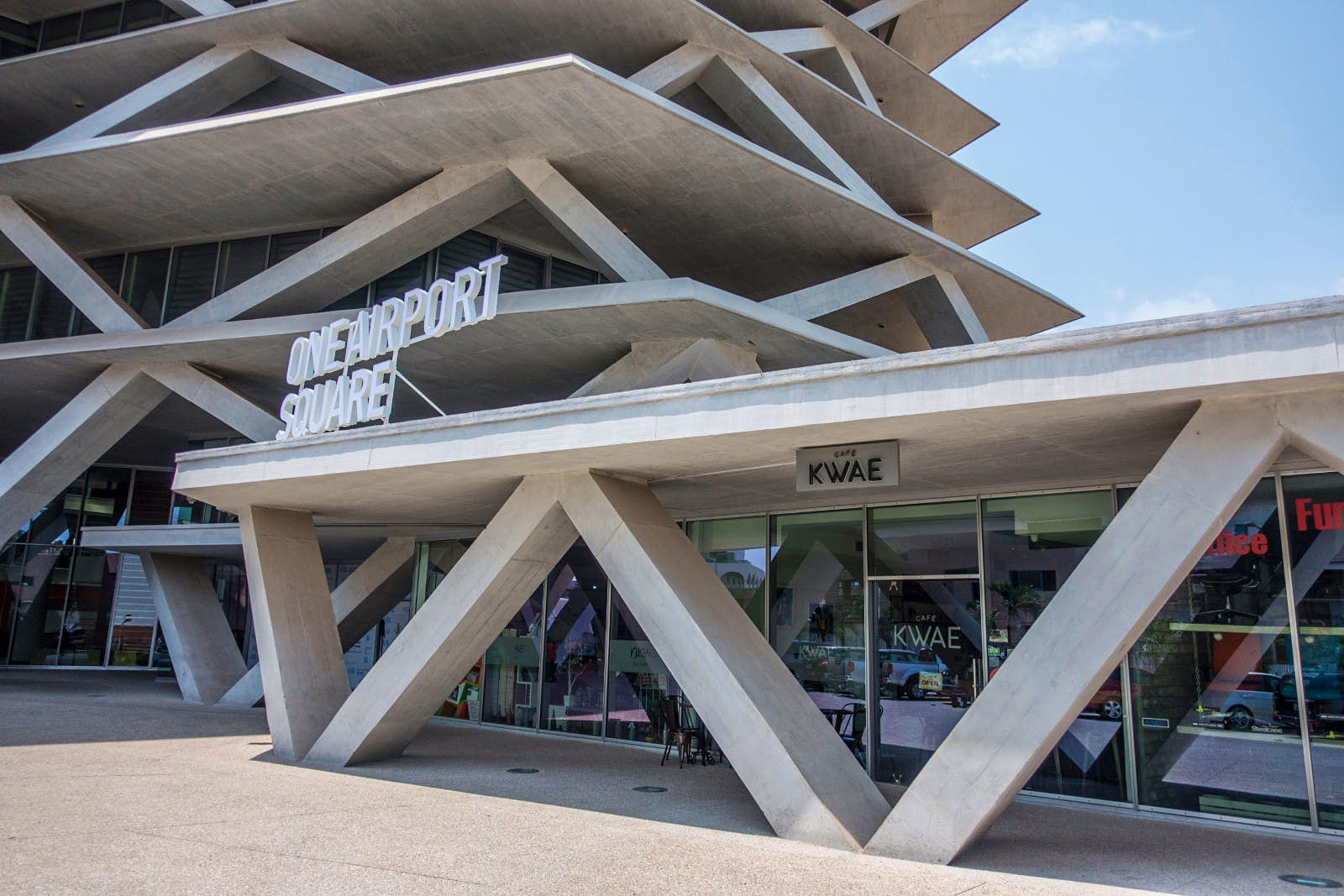 One Airport Square, a new building in Accra that looks like an uneven stack of cards, with each card supported (and separated from the next) by a jumble of massive concrete tootpicks © Elio Stamm / Lonely Planet