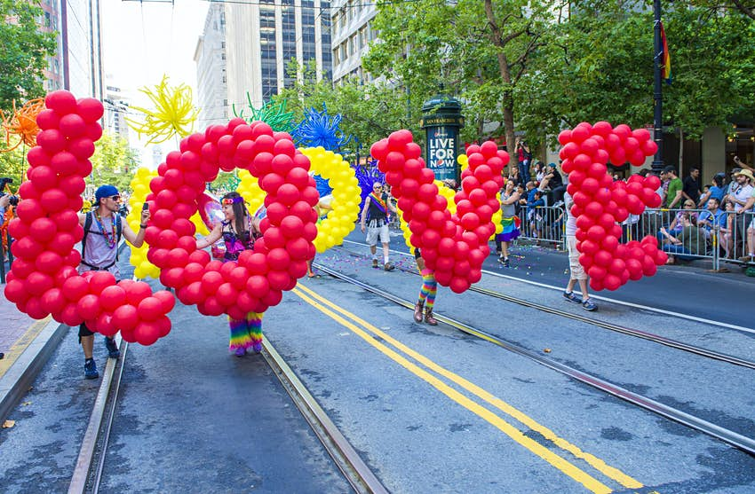 Pride in the US: Parade participants carry balloons to spell out 'LOVE' © Kobby Dagan / Shutterstock